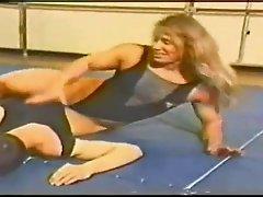 FBB Sharon Marvel wrestling a guy