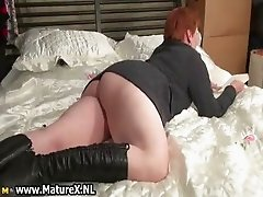 Busty mature  stripping
