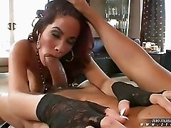 Bootylicious redhead in garter belt and stocking gets licked