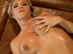 Busty blonde babe fucking in fishnet stockings