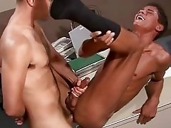 A guys screaming while his ass and cock are attacked by his pal