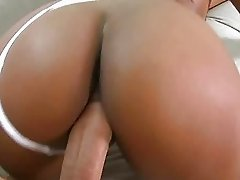 Brown busty Laylani shake her ass and riding dick
