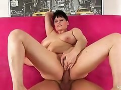 Mature busty Mary bends over