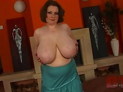 Randy brunette babe in glamurous high heels plays with her mega big tits