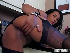 Naughty busty momma plays with fish lips in kitchen
