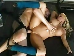 Bootylicious blonde with enormous boobs gets her ass stretched in gym