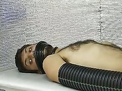 A dude is disposing a special fucking device onto guys cock