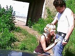 Sexy blonde chick slurps on big shaft outdoors