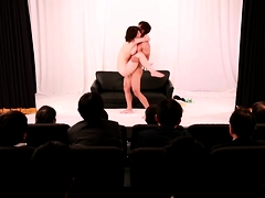 Stacked Japanese babe gets banged hard in front of a crowd