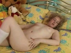 Curly teen masturbating