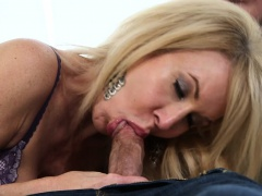 Busty mature in lingerie sucking veiny cock