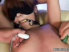 Vibrators pleasure the bound Japanese girl in a kinky scene