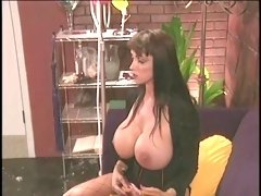 Mistress with huge juggs fooling around with a horny hottie