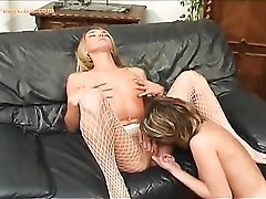 Chick with her fishnets licked by a lesbian