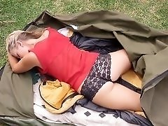 Insatiable blonde masturbates outdoors while camping.