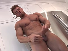 muscled stud jerks of in the kitchen