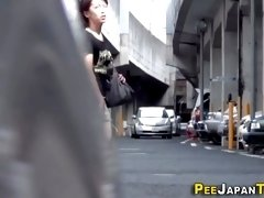 A Asian teens are being spied on by creepy voyeur while having a piss in public