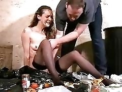 Slim brunette slave is degraded and humiliated with filthy trash