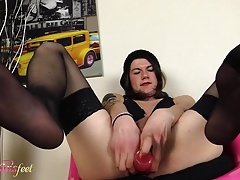 Hot tgirl masturbates showing off her feet in black nylons
