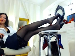 Seductive brunette in stockings reveals her sexy long legs