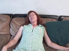 Throbbing cock redhead shemale with short hair strokes cock gently