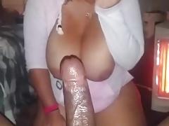 Busty BBW sucking a black cock