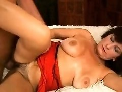 Busty mature brunette has a young guy plowing her hairy cunt