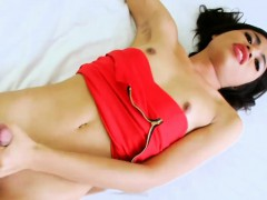 Skinny shemale Bell B jerking off her cock on the bed