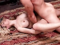 Curly blonde with fake tits sits on a cock
