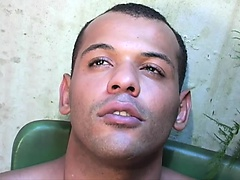 Handsome Brazilian boy wraps his lovely lips around a big black stick