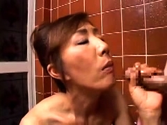Buxom Japanese mom has a young cock satisfying her needs