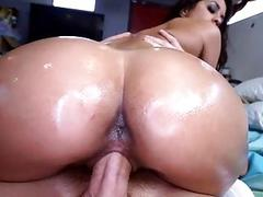 Appealing beauty is riding on white studs cock