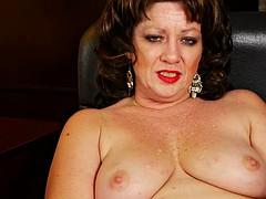 chubby mature woman presents her big jugs