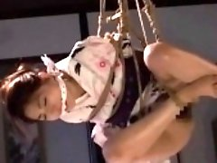 Enchanting Japanese babe gets tied up and is made to cum