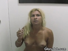 Blonde Smokes Cigarette And Dick Through Glory Hole
