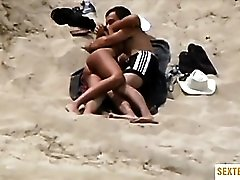 Hot couple caught having sex on the beach