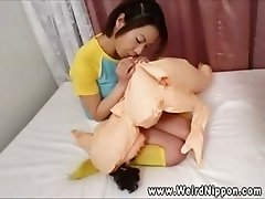 Oriental babe unpacking and blowing up her new friend