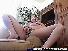 Ginger strips and fingering her pussy on couch