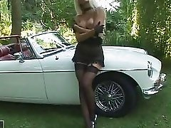 Hot blonde Vega Vixen playing in her hot roadster