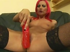Of course she is paying attention to match the colour of the dildo to her hear.
