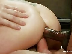 Blonde slut in black stockings gets into prison gang bang